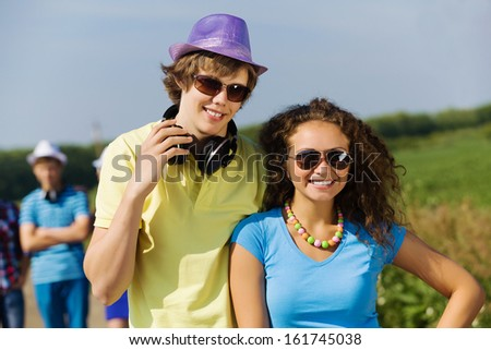 Young man and young woman outdoors. Summer vacation