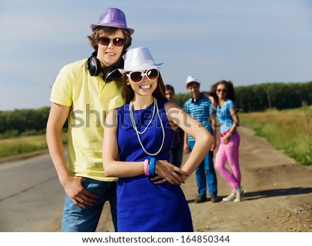 Young man and young woman outdoors. Summer vacation - stock photo