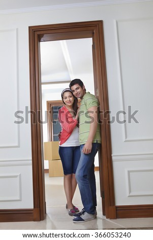 Young man and young woman sitting in the trunk of a car - stock photo