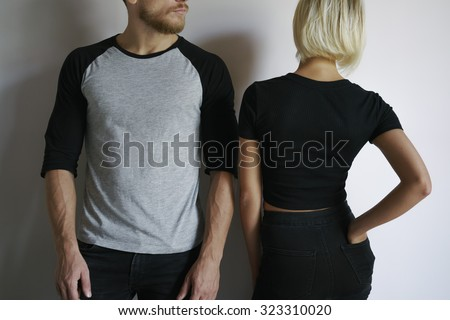 young man and young women posing in t-shirts - stock photo