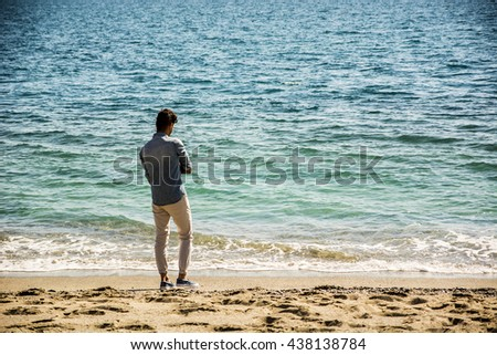 Young Man at Beach in Sunny Summer Day - stock photo