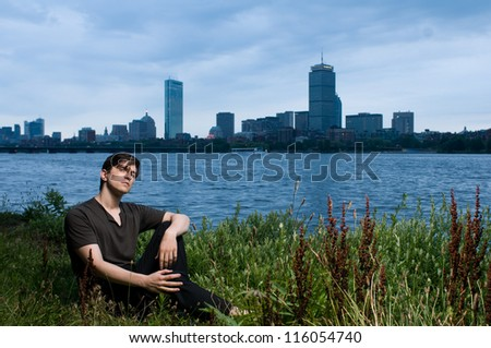 Young man at edge of the Charles River, Boston