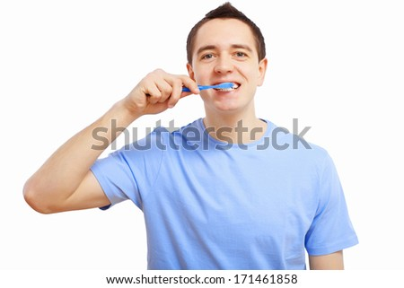 Young man at home brushing teeth in the morning