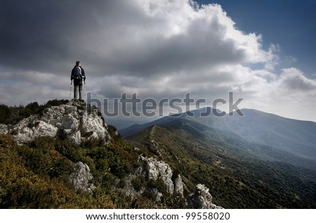 Young man at mountain and clouds