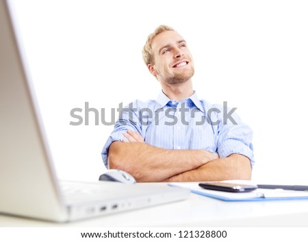 young man at office, sitting leaning back daydreaming, smiling - stock photo