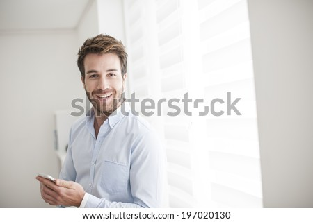 young man at phone receives a good news - stock photo