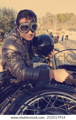 Young man at sidecar bike with glasses - stock photo
