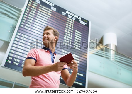 Young man at the airport - stock photo