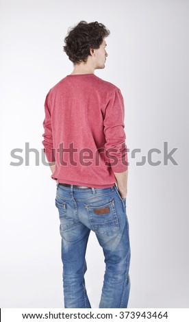 Young man back portrait in red blouse.