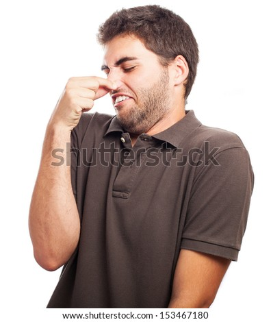 young man bad smelling on a white background