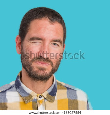 young man blink eye concept - stock photo
