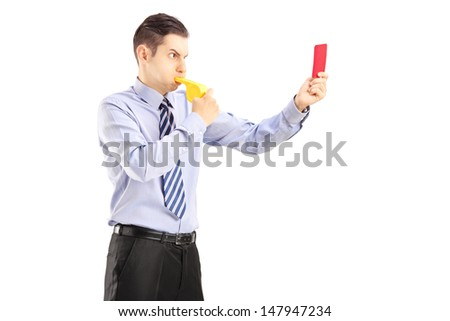 Young man blowing a whistle and showing a red card, isolated on white background - stock photo