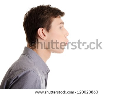 Young man blowing on something , isolated