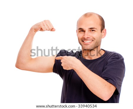 Young man boasting of his biceps
