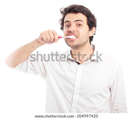young man brushing his teeth - stock photo