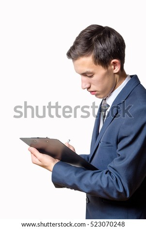 young man businessman holding clipboard and read in the office