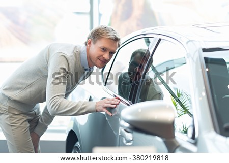 Young man buying a car - stock photo