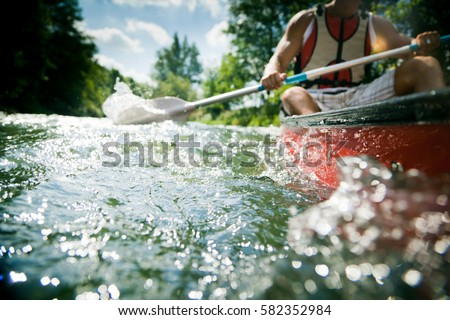Young Man Canoeing
