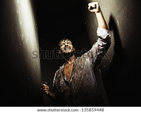 Young man carried away by euphoria - stock photo