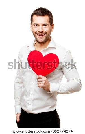 Young man carries heart shaped red card isolated on white - stock photo