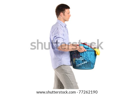 Young man carrying a laundry basket isolated on white background