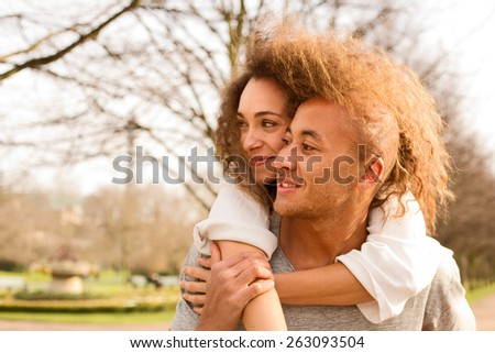 young man carrying his girlfriend  - stock photo