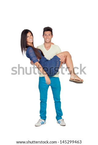 Young man carrying his girlfriend in his arms isolated on white background
