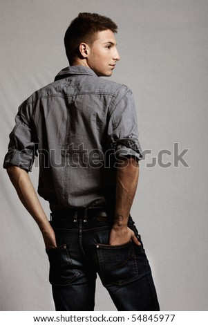 young man casual wear from the back, studio shot