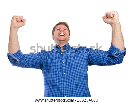 young man celebrating his success - stock photo