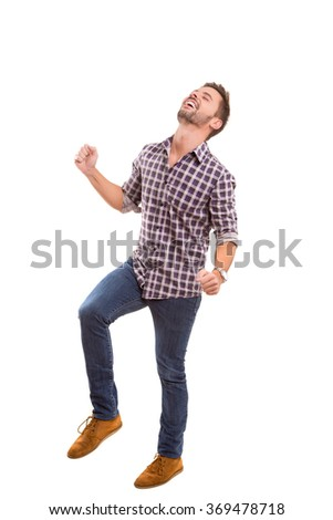 Young man celebrating - isolated over white background