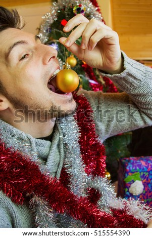 Young man celebrating the christmas day in a very good mood