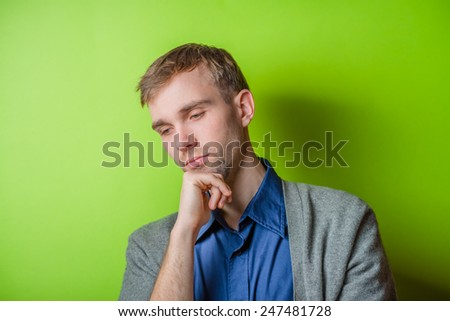 Young man  chin resting on his hands  with an intent sincere expression