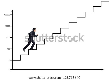 Young man climbs the ladder of growth chart - stock photo