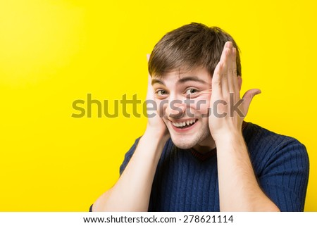 young man closed his ears with his hands - stock photo
