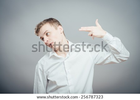 young man committing suicide with imaginary gun