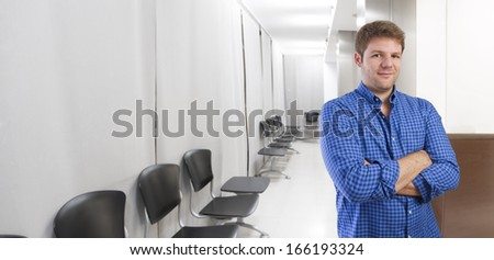young man confidence gesture in office or waiting room - stock photo