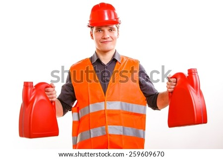 Young man construction worker in orange safety vest and red hard hat holding plastic canisters isolated on white. Industrial power and energy. Studio shot. - stock photo