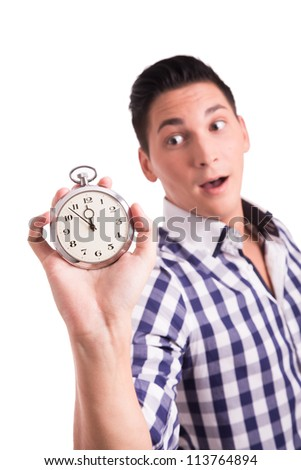 Young man counting the minutes on a watch until the deadline is reached - stock photo