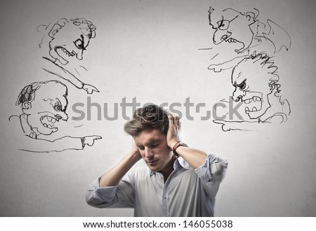 young man covers his ears with his hands - stock photo
