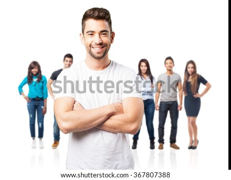 young man crossing arms