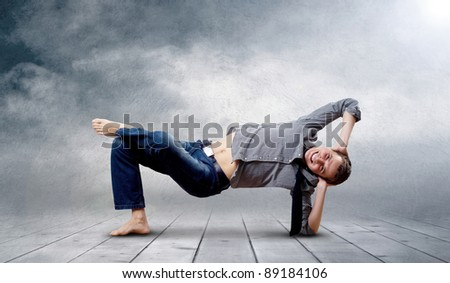Young man dancer in new stay pose - stock photo