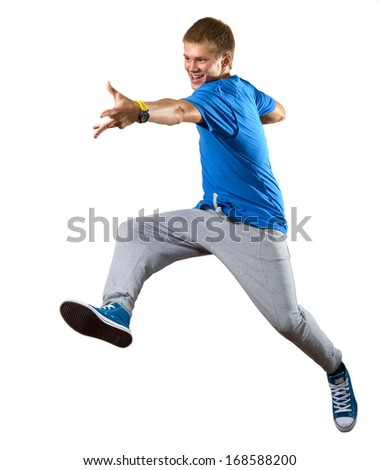 Young man dancer jumping isolated on white - stock photo