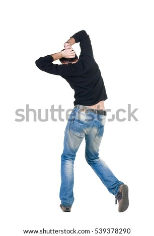Young man dancing. Rear view. Isolated over white