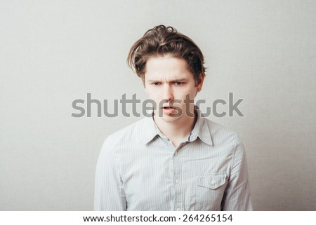 young man dissatisfied - stock photo