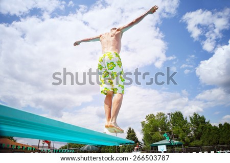 Young man diving off a diving board