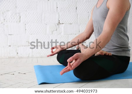 Young man do yoga indoor, yoga lotus position