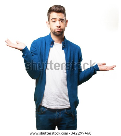 young man doing a balance gesture - stock photo