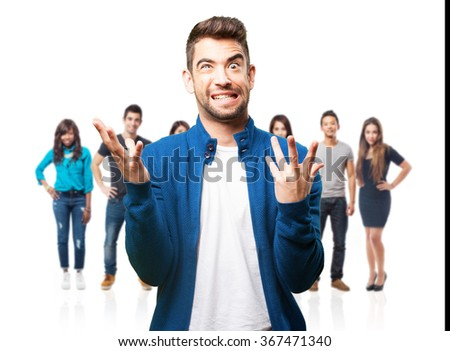 young man doing a crazy gesture - stock photo