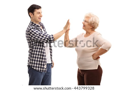 Young man doing a high five with his grandmother isolated on white background