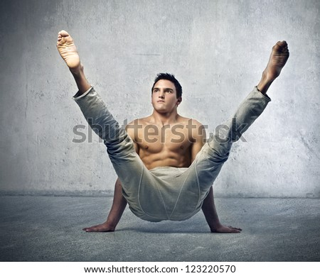 Young man doing an exercise - stock photo